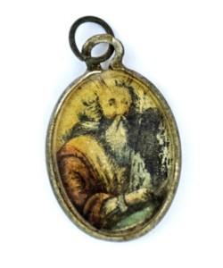 Metalowy medalion z wizerunkiem Mojżesza, photo credit: Yoram Haimi, Israel Antiquities Authority